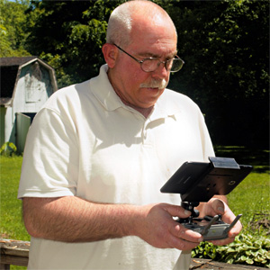 Aerotech Photography owner Mike Smith operating one of his drones